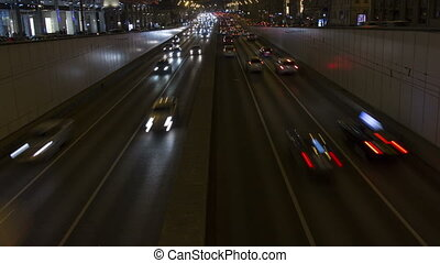 Lights of night city. Cars and road timelapse