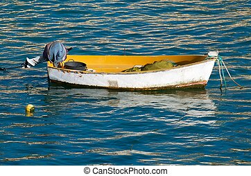 Small wooden boat at the beach of La Caleta, Cadiz,...