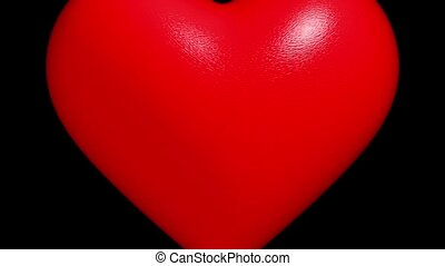 Red heart on black