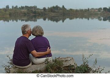 sitting near lake
