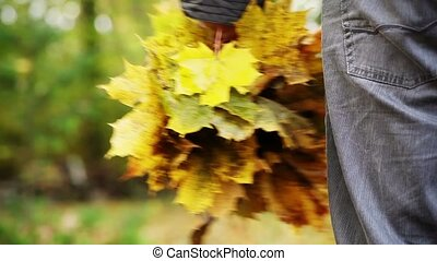 Man with yellow autumn leaves