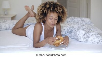 Young Woman Enjoying Breakfast In Bed - Pretty african...