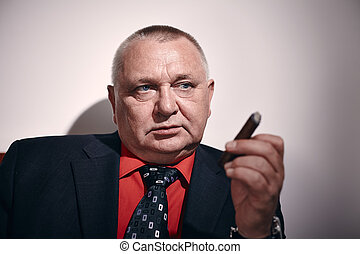 Man with cigar closeup - Close up portrait of serious middle...
