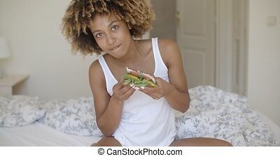 Woman Having Breakfast In Bed - Young african american woman...