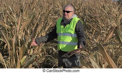 Anxious farmer on cold corn field