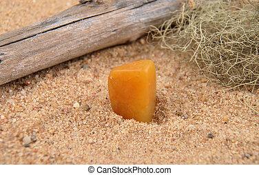 Orange calcite on beach