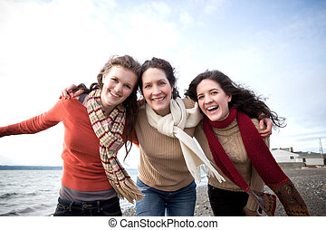 Mother and daughters - A mother having fun with her...