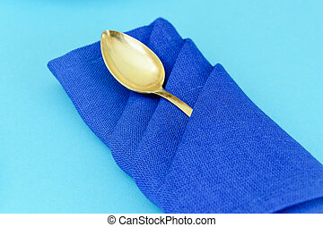 Silver Tableware: Spoon. Isolated on Blue Background.