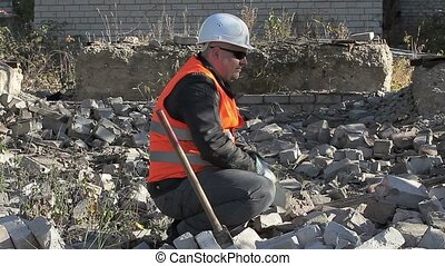 Worker at outdoors throw bricks