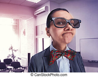 Funny thoughtful nerd girl in glasses in the office
