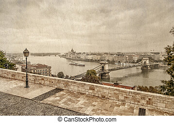 View over Danube river in Budapest with parliament building...