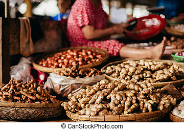 ginger root and herbs at asian steet market in Vietnam