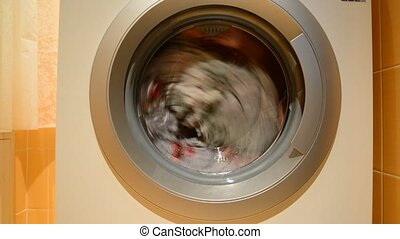 The dirty laundry is washed in  washing machine