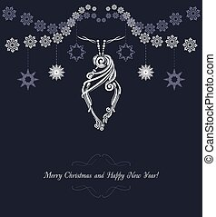 Ornamental Christmas tinsel on the dark background. Vintage...