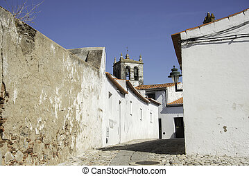 evora old street - typical white walls in evora city in...