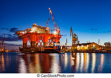 Shipyard at night - Oil Rig in the shipyard for maintenance...