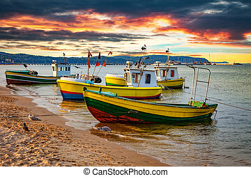 Boats in Sopot, Poland - Picturesque landscape of a sunset...