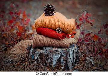 Stack of knitted sweaters on the wood - Stack of knitted...
