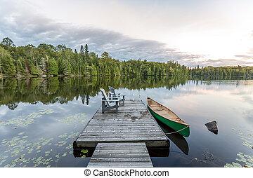 Canoe and Dock - Ontario, Canada - Canoe Tied to a Dock -...