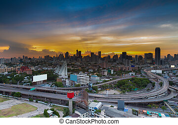 Sunset of highway interchange - City downtown and highway...