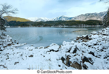 Eibsee lake winter view. - Eibsee lake winter view with thin...