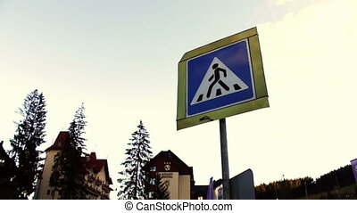 Sign of the pedestrian crossing on background sky and...