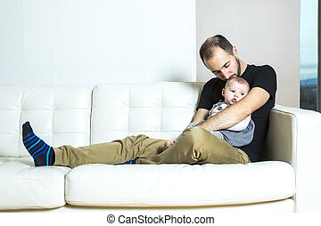 Father with baby on the sofa