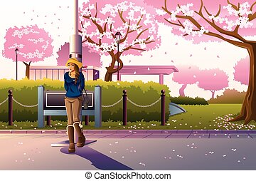 Girl Walking During Cherry Blossom