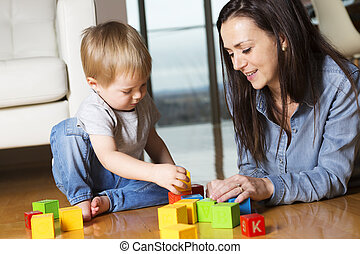 mother play block with his son at home
