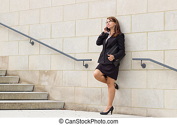 Business woman talks on cell phone
