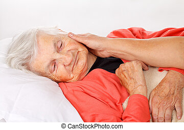 Home care - Seniors woman with her caregiver at home