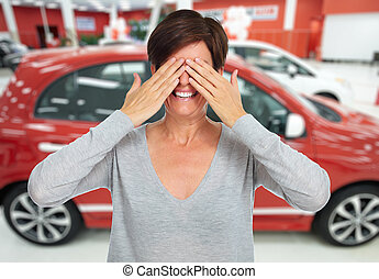 Car dealer. - Woman hiding her face with hands. Auto...