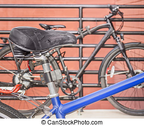 Black worn leather bicycle seat with spring suspension and...