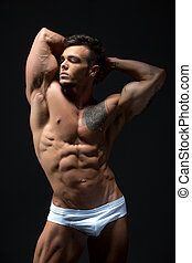 Attractive young man with muscular fit body