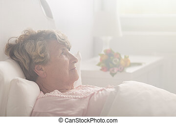 Retired person in hospital room - Picture of ill retired...