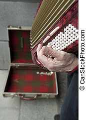 Man playing accordian - Street performer playing music on a...
