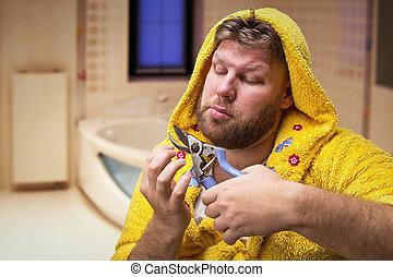 Strange man cuts his nails