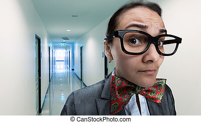 Scared office girl in glasses is walking to the manager's...
