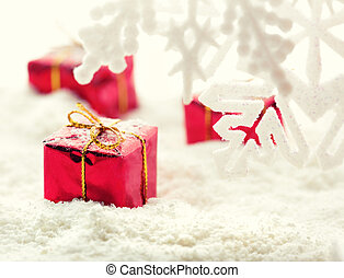 Gifts on snow - Red gift boxes with white snow shot