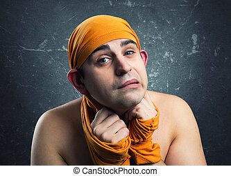 Crazy man weared yellow textile on head