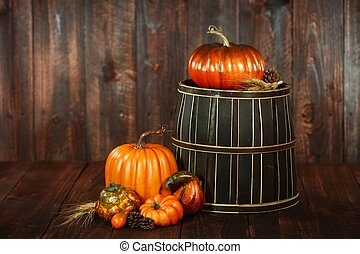 Fall Themed Scene With Pumpkins on Wood