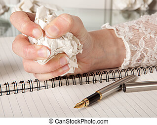 Writer\'s frustration - Frustrated hand squeezing a crumpled...