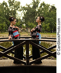 Beautiful Japanese woman girl with her double in kimono in...