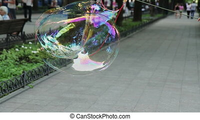 Street Performer Blows Bubbles - Street performer blows big...