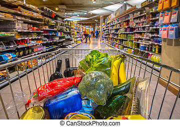 Supermarket cart filled up with products - Grocery cart at a...