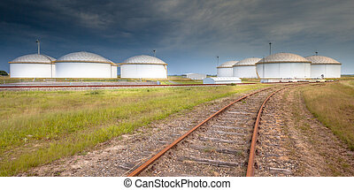 Railroad to a giant oil tank terminal - Panorama of a...