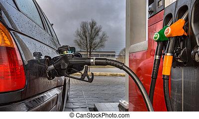 Fuel station pump nozzle close up - Gas station car...