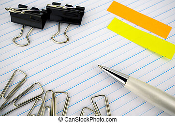 Stationery and Notebook paper with lines.