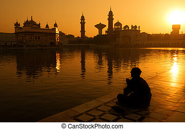 Sikh pilgrims at Golden Temple India - Sikh pilgrims sitting...