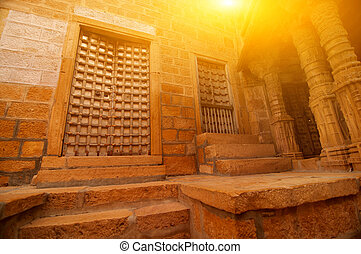 Inside Jaisalmer fort - Details of carved walls and doors of...